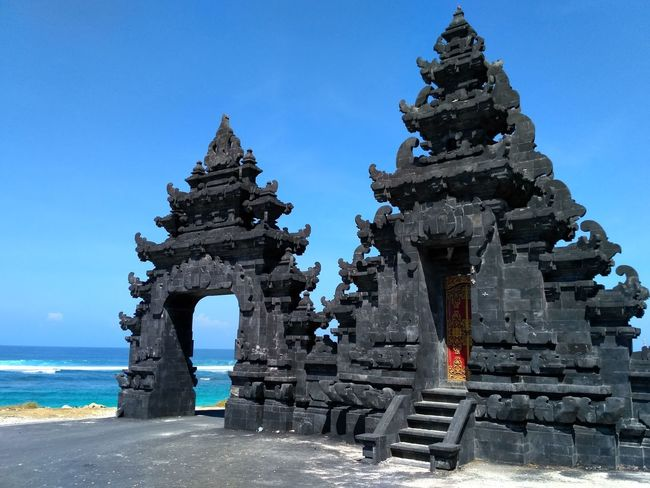 Melasti beach, Bali, Indonesia Architecture Religion Place Of Worship Built Structure History Sky Travel Destinations Horizon Over Water Rock Ocean View Sand Beach Sea View Travel Surf Ocean Sand Bali, Indonesia Landscape Beauty In Nature Wave Water Sea Beach Tourism No People