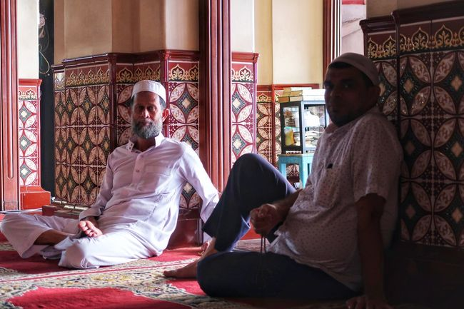Muslims in the Mosque People Men Sitting Portrait Looking At Camera Muslims Mosque Quiet Place