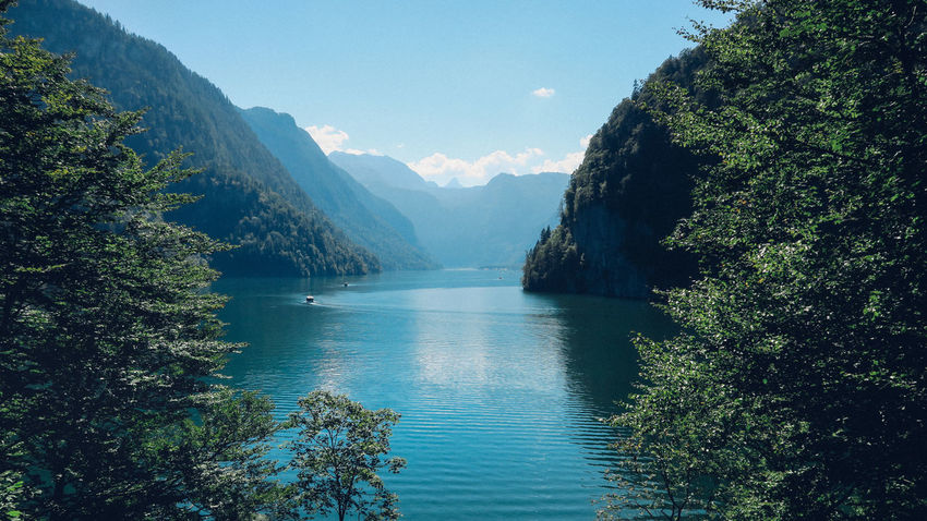 A stunning view of the lake through the trees Königssee Nature Alps Beauty In Nature Day Forest Germany Growth Idyllic Lake Lake View Mountain Mountain Range Mountains Nature Nature_collection No People Outdoors Scenics Sky Tranquil Scene Tranquility Tree Water