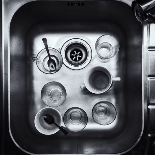 Directly above shot of cups in kitchen sink