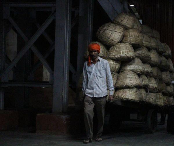 Man Pulling Cart With Stack Of Wicker Baskets At Chhatrapati Shivaji Terminus