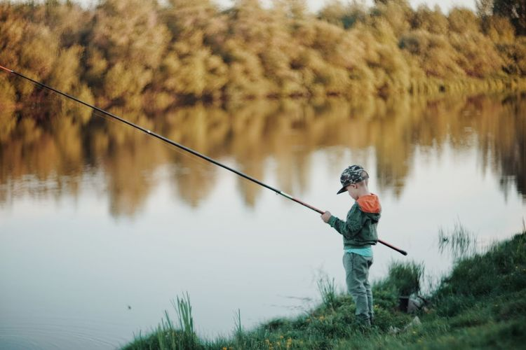Man fishing in lake