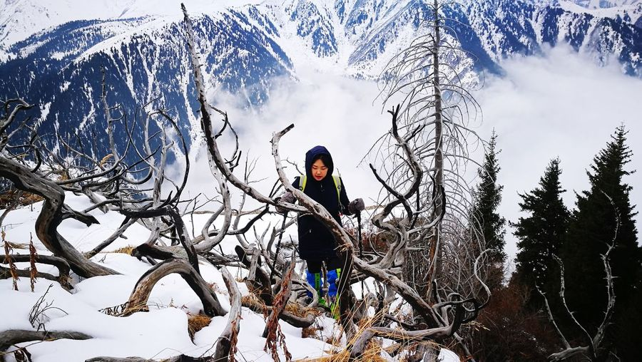 Almatymountains Kazakhstan Women Nature Activity Day Beauty In Nature Activity Hikingadventures Hiking EyeEm Selects Weekend Activities Trip Wintertrip Mountain Ridge Tree Snow Winter Full Length Sky