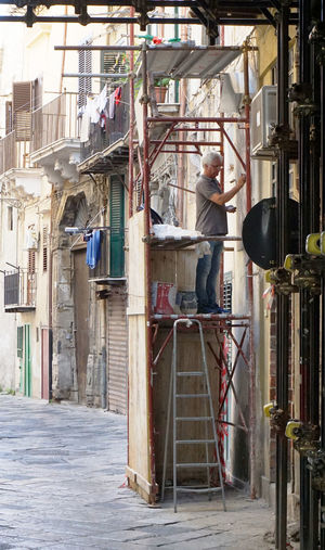 working man in Palermo, Sicily, Italy Alley Palermo Travel Destinations Tourism Working Man At Work Ladder Architecture One Person Real People
