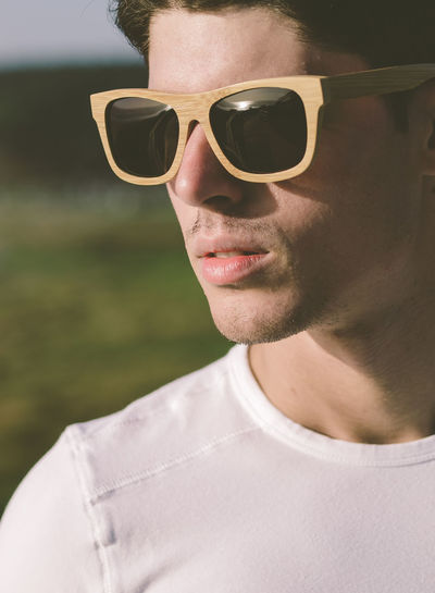 Close-up of young man wearing sunglasses
