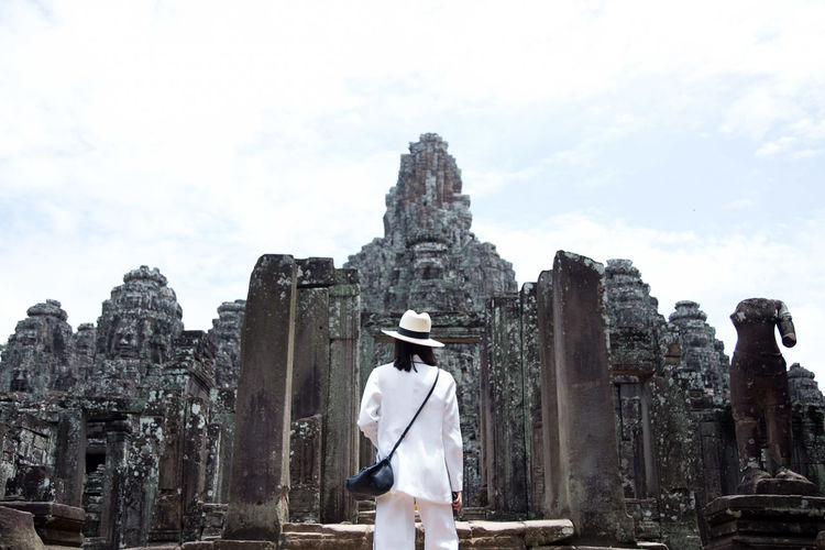 Man standing at historic temple