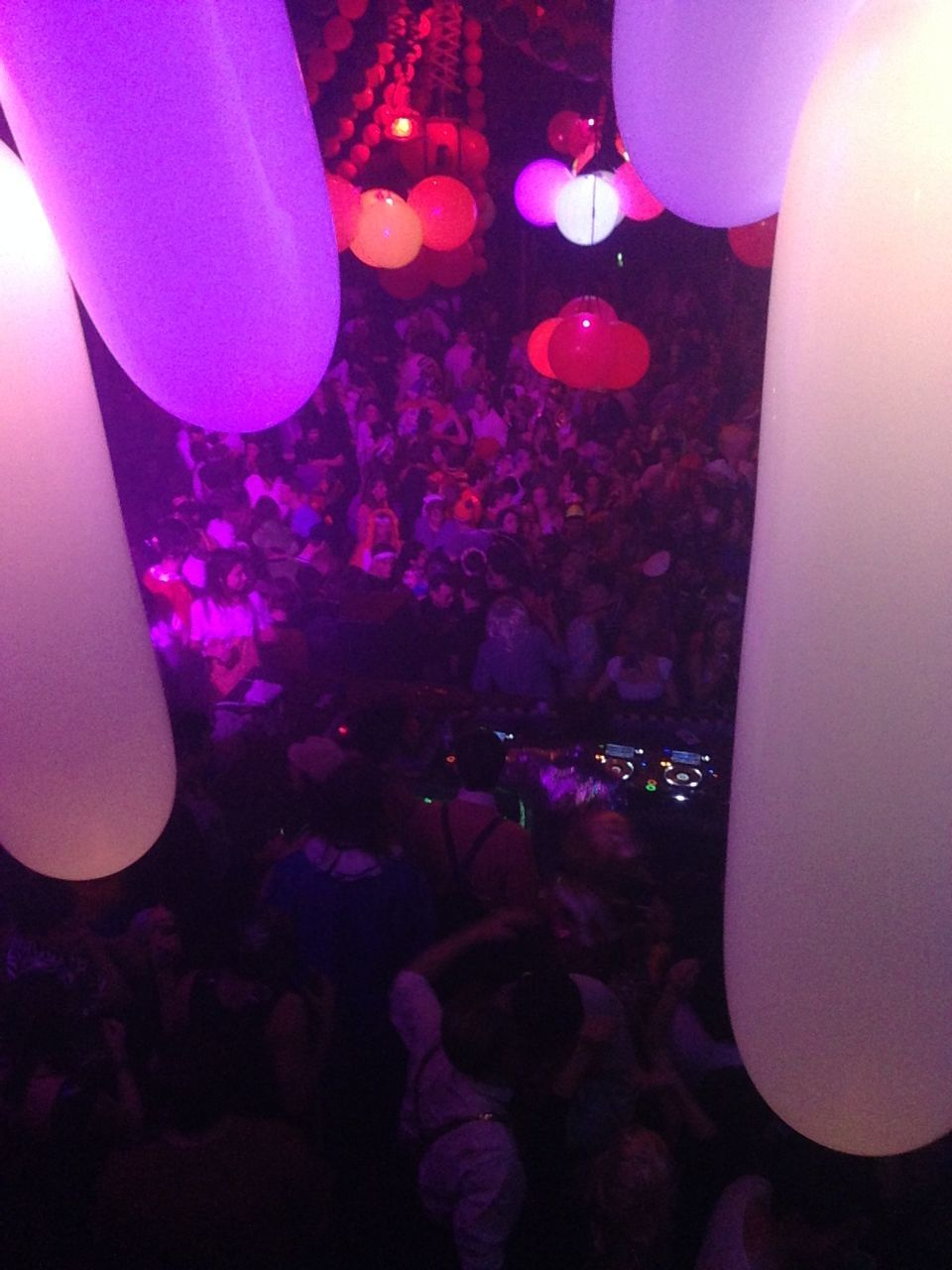 illuminated, lighting equipment, indoors, arts culture and entertainment, celebration, nightlife, nightclub, night, large group of people, balloon, crowd, party - social event, disco lights, people