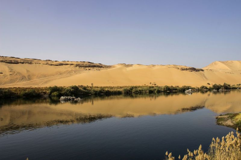 Reflection NileRiver Reflection Water Nature Sky Outdoors No People Day Landscape Clear Sky Beauty In Nature EyeEm TheWeekOnEyeEM EyeEmNewHere EyeEm Selects Aswan Travel EyeEm Nature Lover Vacations Lost In The Landscape