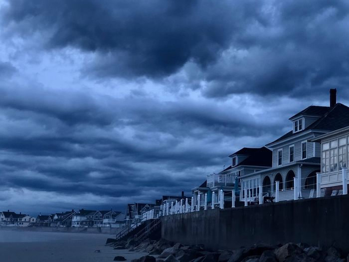 HUAWEI Photo Award: After Dark Architecture Beauty In Nature Building Building Exterior Built Structure City Cloud - Sky Cold Temperature Dramatic Sky Dusk Nature No People Ominous Outdoors Overcast Sky Snow Storm Storm Cloud Water Winter