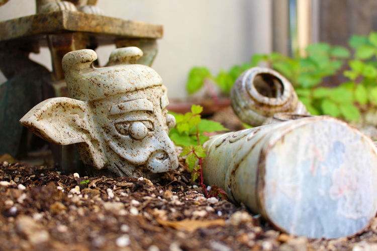 A broken statue of a fire imp, abandoned in a Korean park. Ancient ASIA Asian Culture Broken Broken Statue Broken Stone Carving - Craft Product Close-up Deterioration No People Old Outdoors Run-down Selective Focus Statue Stone Stone - Object Stone Material Surface Level The Past
