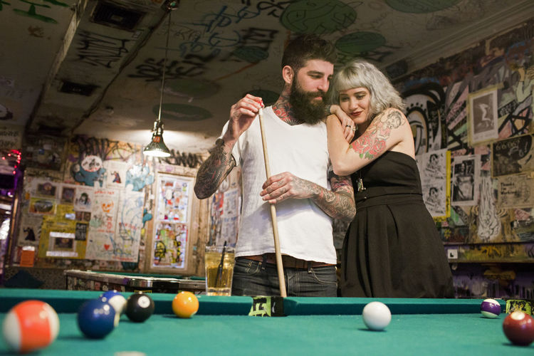 High angle view of couple with ball on table