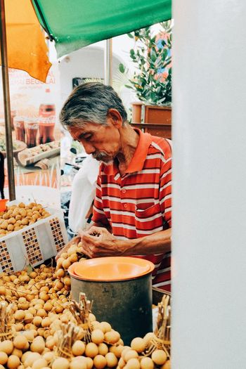 Man preparing food in container
