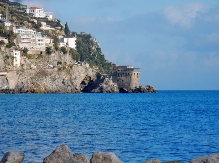 Sea Water Building Exterior Built Structure Architecture Sky Building Nature Scenics - Nature Rock Land Beach Day Waterfront Beauty In Nature No People Rock - Object Horizon Over Water Solid Outdoors Amalfi Coast