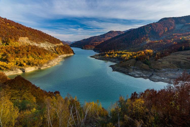 Scenic view of lake and mountains against sky during autumn