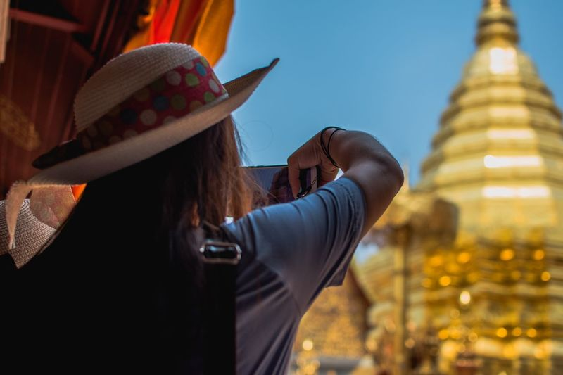 EyeEm Selects Hat Clothing One Person Architecture Building Exterior Built Structure Women Adult Place Of Worship Building Religion Travel Destinations Rear View Tourism Waist Up Spirituality Lifestyles City Belief Outdoors