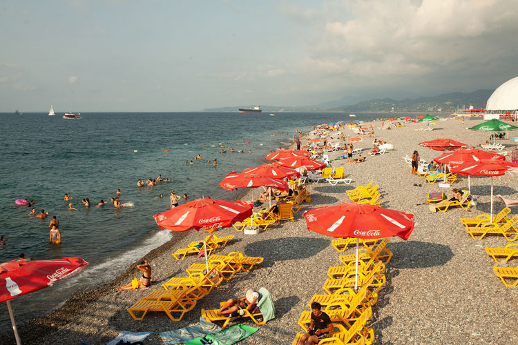 Summer beach at the Batumi Georgia 2018 Sea Water Sky Horizon Beach Horizon Over Water Nature Land High Angle View Group Of People Day Crowd Cloud - Sky Beauty In Nature Large Group Of People Sand Parasol Leisure Activity Architecture Outdoors
