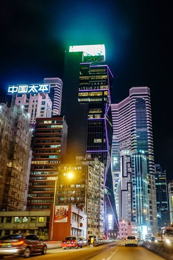 Discoverhongkong Nightphotography Reframinghk Streetphotography Illuminated Night Architecture Building Exterior City Built Structure Building Transportation Office Building Exterior Tall - High Street Modern Skyscraper Cityscape City Life No People Road Motor Vehicle Tower Car