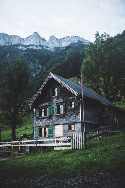Weekend getaway in the mountains. Switzerland Plant Tree Architecture Built Structure Sky Nature Day No People Building Exterior Growth Grass Mountain Outdoors Land Green Color Field Building Cloud - Sky Forest