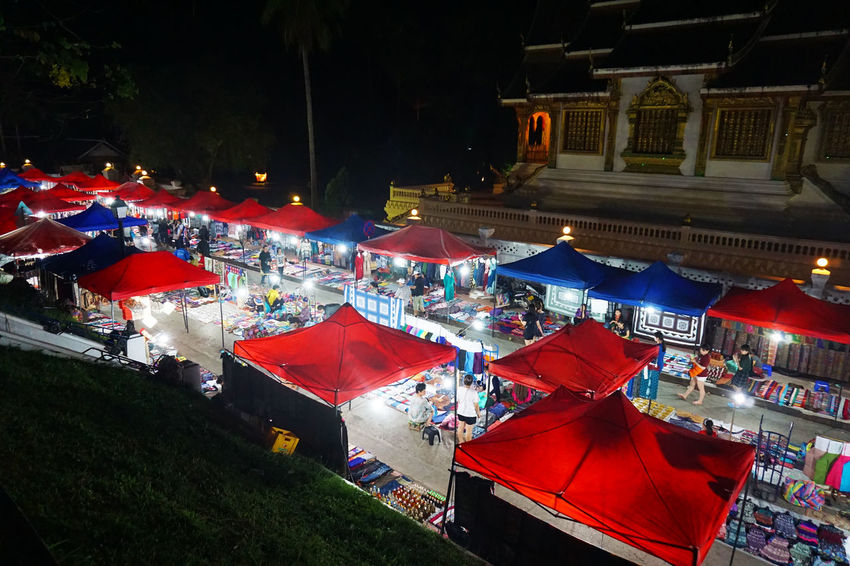 2017 Architecture Building Exterior Built Structure Crowd Group Of People High Angle View Illuminated Laos Large Group Of People Luang Phabang Luang Prabang Market Market Stall Night Night Market Outdoors People Real People Shop Shoppimg ナイトマーケット ラオス ルアンパバーン
