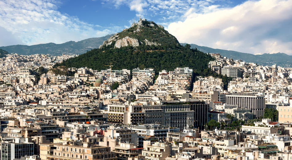 View of Lycabettus Hill - Athens, Greece Lycabettus Hill Architecture Athens Building Exterior Built Structure City Cityscape Cloud - Sky Crowded Day Greece Mountain Mountain Range Nature Outdoors Residential Building Sky