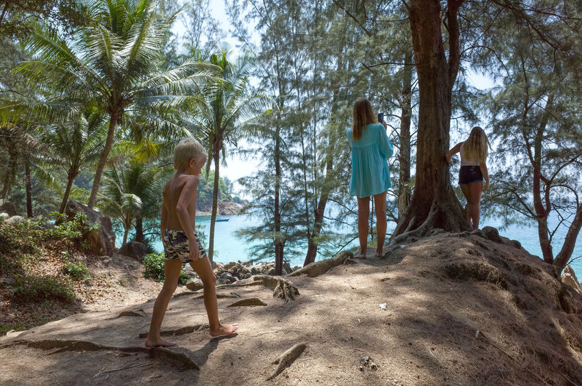 In the jungle near Banana Beach, Phuket, Thailand Girls And Boys Holiday Kids Phuket Summertime Taking Photo Tropical Forest Vacations Welcome To The Jungle Youth Of Today Andaman Sea Banana Beach Boys And Girls Childhood Girls Jungle Leisure Activity Lifestyles Outdoors Palm Trees Posing Real People Sea Summer Tropical Climate The Traveler - 2018 EyeEm Awards