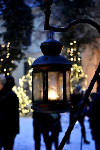Close-Up Of Illuminated Lighting Equipment Hanging Outdoors At Dusk