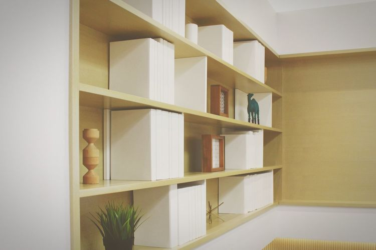 Shelves attached in wall at home