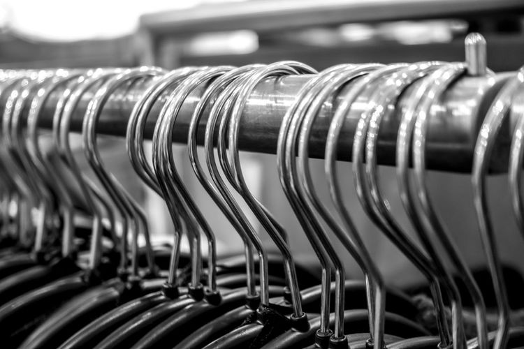 Close-up of coathangers hanging on clothes rack