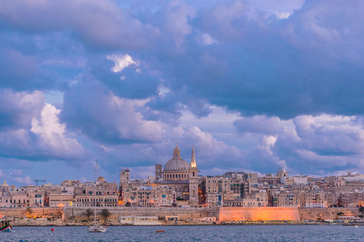 Different view of the Valletta skyline Cloud - Sky Architecture Building Exterior Built Structure Sky Building Travel Destinations Travel Nature City Outdoors Malta Maltaphotography Maltascapes cityscapes Cityscape Travel Photography Travelling Valletta Valletta,Malta Valletta European Capital Of Culture 2018 Historical Building Waterfront Historic Building Architecturelovers Architecture Bluehour Blue Hour Blue Hour Cityscape Harbour View Harbor Citylights Mediterranean  Travelphotography Seaside