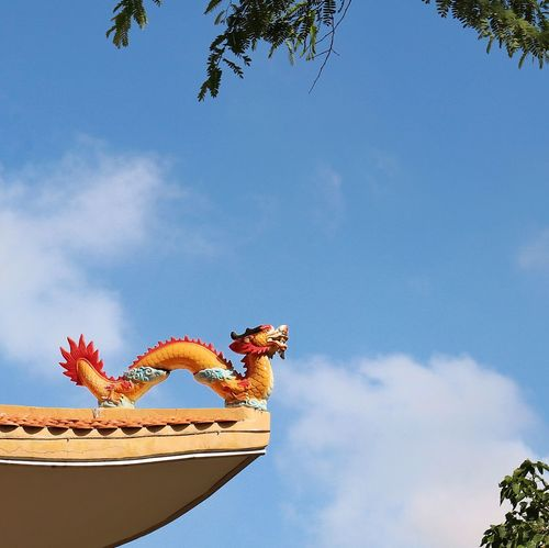 Animal Representation Dragon Day No People Low Angle View Sky Sculpture Nature Tree Chinese Dragon Outdoors Animal Themes Statue Reptile