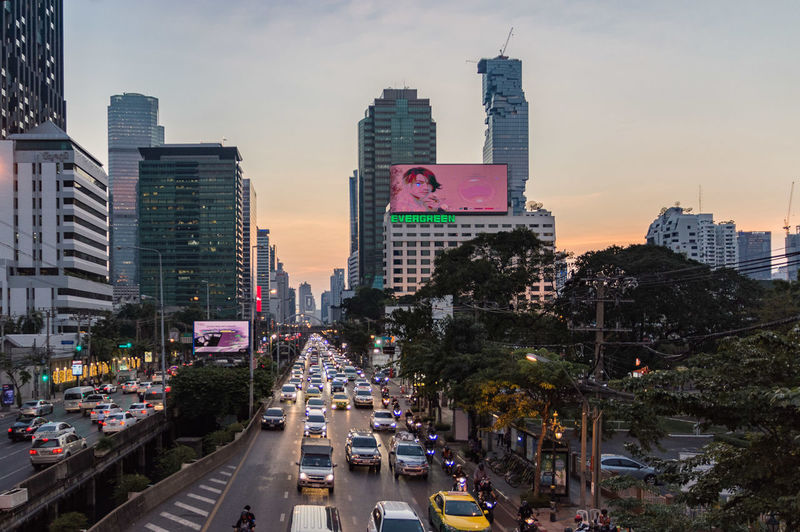 Bangkok Bangkok Thailand. Architecture Building Building Exterior Built Structure Car City City Life City Street Cityscape High Angle View Incidental People Mode Of Transportation Motor Vehicle Office Building Exterior Outdoors Road Sky Skyscraper Street Sunset Tall - High Transportation
