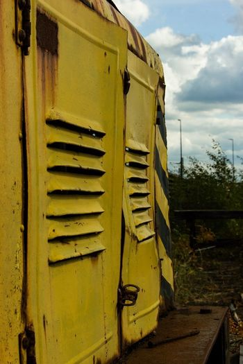 Old Train Train EyeEm Gallery EyeEm Selects EyeEm Best Shots Day No People Nature Sky Yellow Cloud - Sky Built Structure Close-up Sunlight Building Exterior Land Plant Wall - Building Feature Field Outdoors Architecture Metal Old Rusty Wall