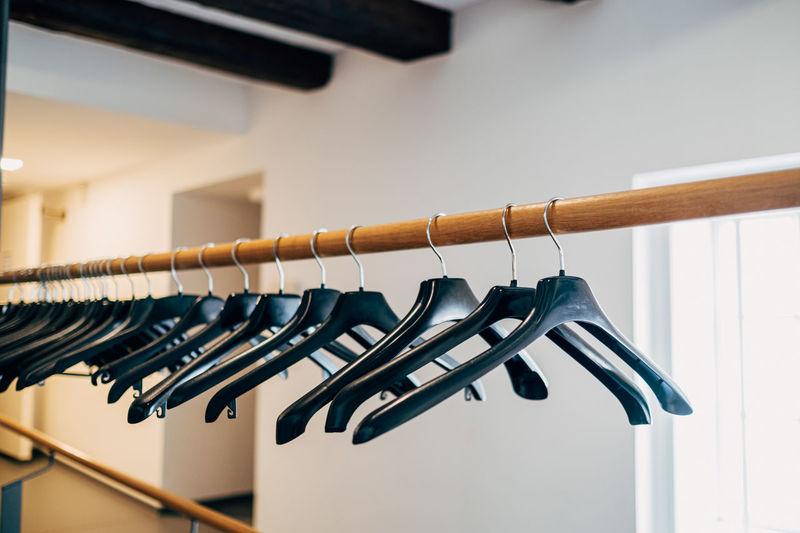 Black plastic coat hanger on wardrobe