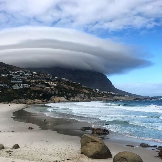 Lenticular mountain Cloud - Sky Water Sky Sea Beach Scenics - Nature Beauty In Nature Outdoors Mountain Nature Day