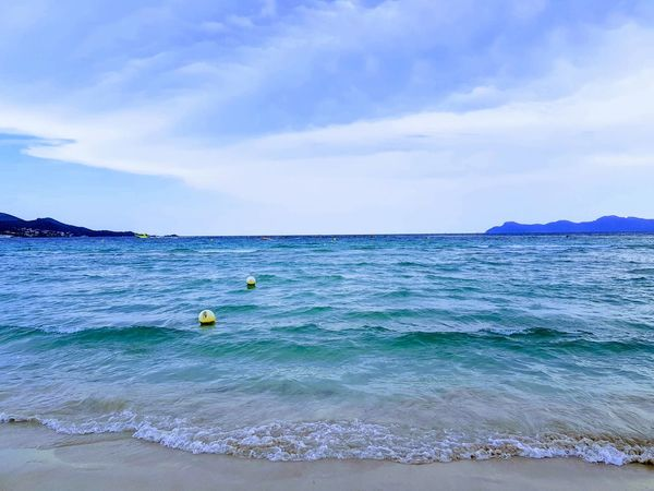 Platja de Muro Beach Beauty In Nature Cloud - Sky Day Floating On Water Horizon Horizon Over Water Idyllic Inflatable  Land Motion Nature No People Outdoors Scenics - Nature Sea Sky Tranquil Scene Tranquility Turquoise Colored Water Waterfront Wave