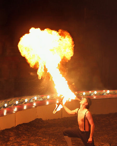 Fire-Eater Performing In Circus