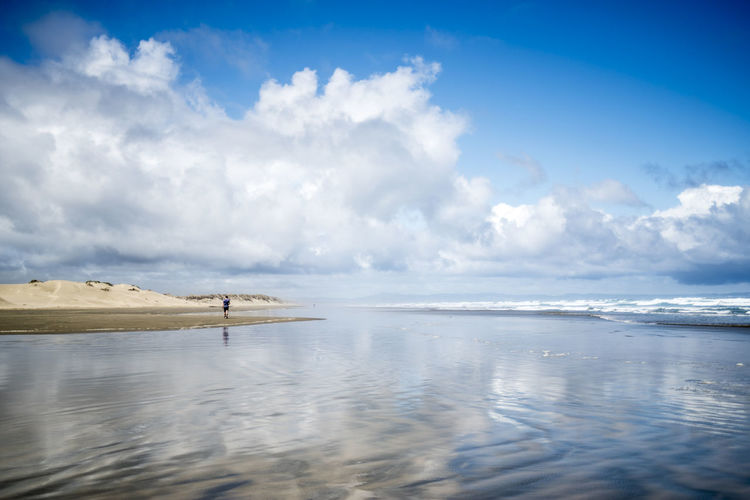 90 Mile Beach Scenery Beauty In Nature Blue Calm Cloud Cloud - Sky Cloudy Coastline Cumulus Cloud Day Idyllic Incidental People Majestic Nature No People Non-urban Scene Ocean Outdoors Reflection Scenics Sea Seascape Sky Tranquility Water Waterfront