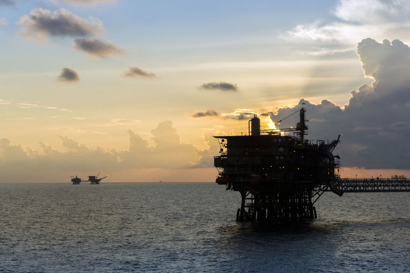 oil and gas industry Ocean Wave Petroleum Upstream Offshore Offshore Life Oil And Gas Drilling Rig Oil Pump Sea Offshore Platform Water Sunset Industry Silhouette Business Finance And Industry Oil Industry Crude Oil Natural Gas Fossil Fuel Oil Well Oil Field Oil