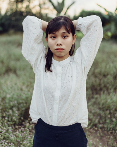 Portrait of a teenage girl standing on field