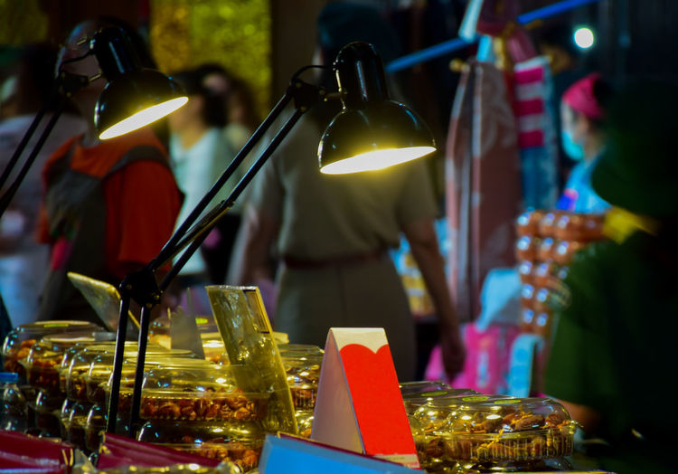 Close-up of illuminated lighting equipment on table