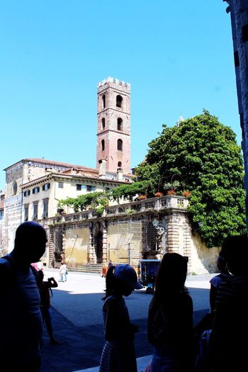 Lucca Italy Italy Lucca Architecture_collection Church Architecture Church Tourism Tourist Attraction  Tourist Architecture Building Exterior Built Structure Tree Sky Group Of People Real People Building Lifestyles Outdoors Crowd Plant Clear Sky