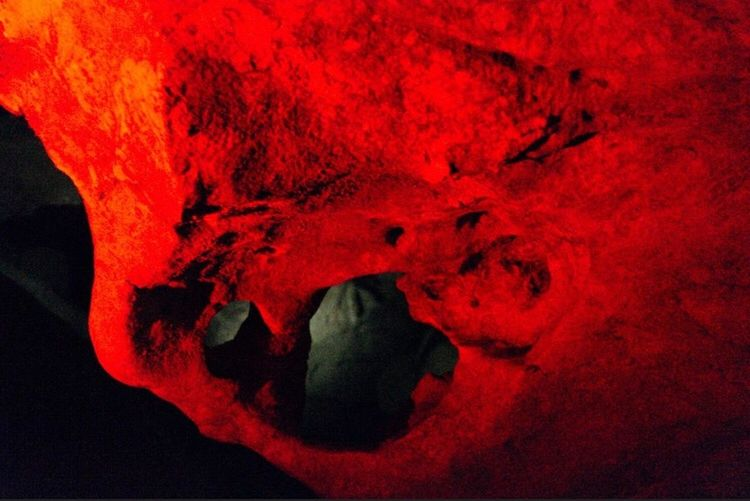 Prometheus Caves Red Human Body Part Close-up Indoors  Body Part People Vibrant Color Built Structure Textured  Spooky Orange Color Creativity Paint Architecture Human Limb Art And Craft Fear Studio Shot
