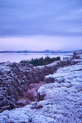 Sky Beauty In Nature Scenics - Nature Tranquil Scene Water Tranquility Cold Temperature Winter No People Snow Cloud - Sky Nature Sea Non-urban Scene Plant Idyllic Land Environment Purple Vertical Composition Thingvellir National Park Tectonic Plates Iceland