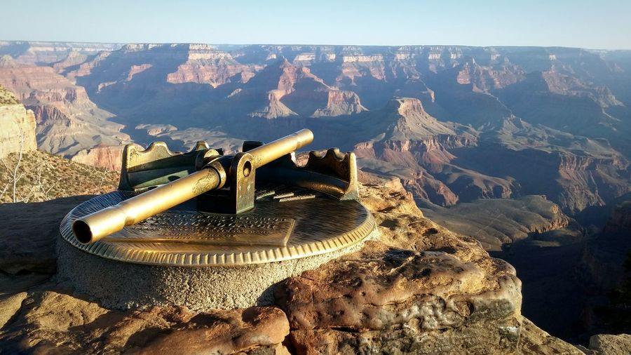 Telescope on rock against rocky landscape in grand canyon national park