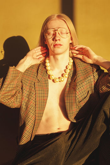 Man wearing pearl necklace