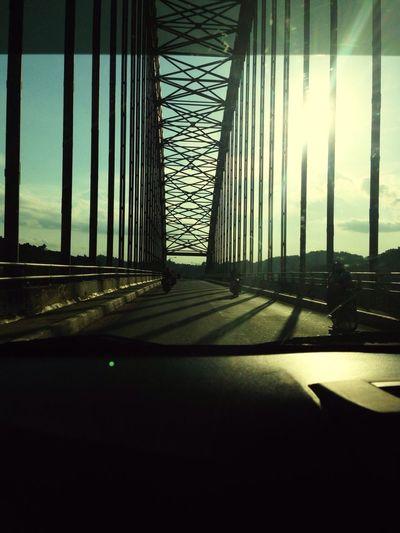 Sun glare burn on Loa bakung bridge, Samarinda. Samarinda Loabakung Bridge Eastkalimantan  Eastborneo INDONESIA IPhone
