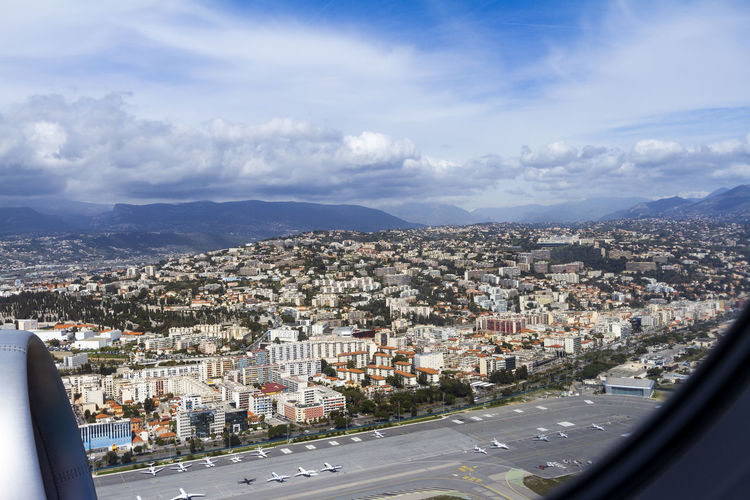 Coastline of Nice, France City Architecture Building Exterior Built Structure Cityscape Cloud - Sky Sky Transportation Residential District Mountain Day Mode Of Transportation Nature Building No People Road High Angle View Outdoors TOWNSCAPE Nice France Mediterranean