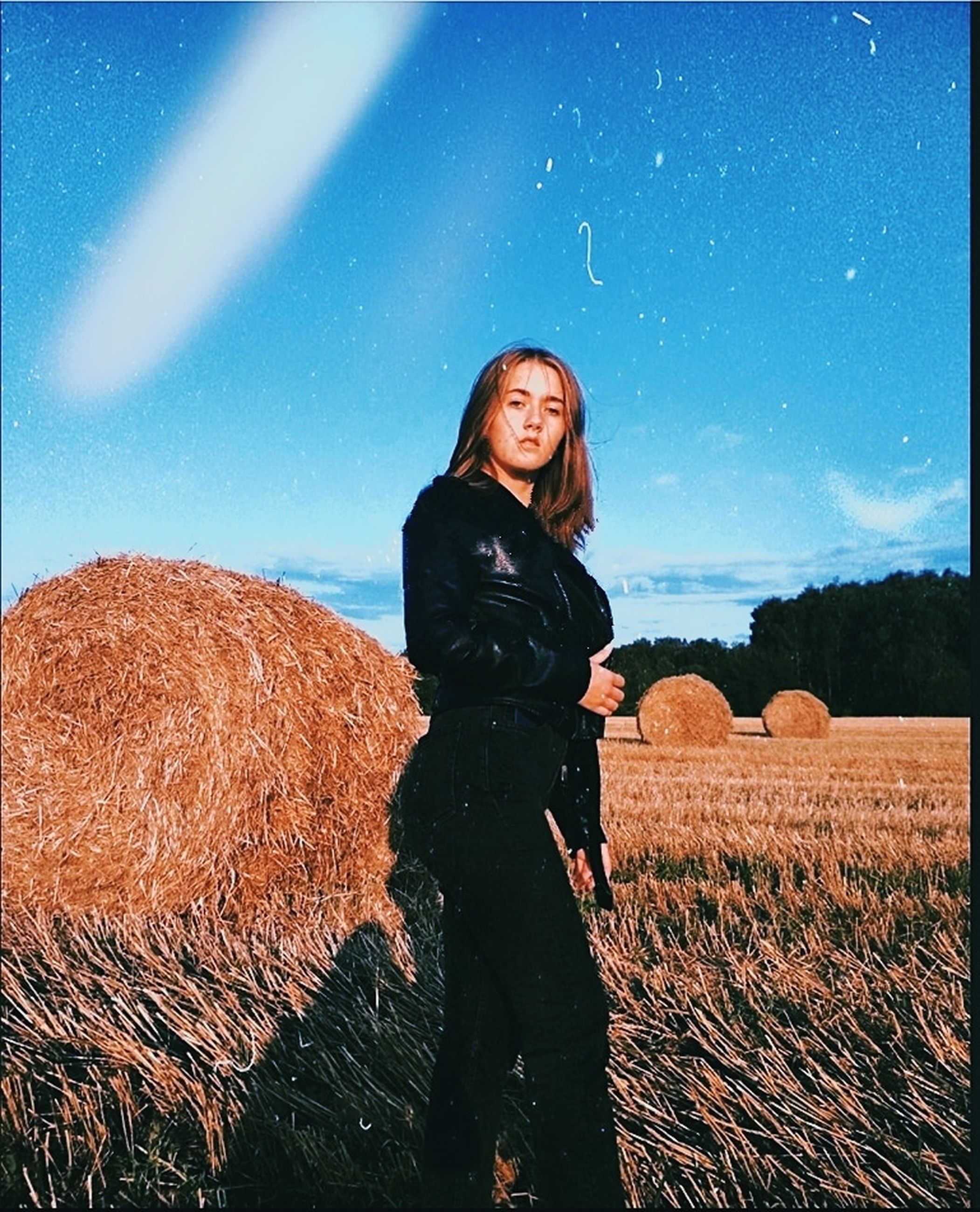 field, one person, real people, land, young women, sky, lifestyles, young adult, leisure activity, standing, nature, three quarter length, casual clothing, farm, environment, plant, women, landscape, outdoors, beautiful woman, hairstyle