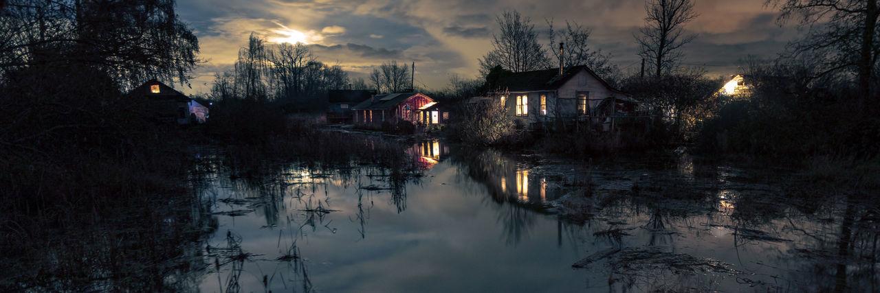 Canal Amidst Buildings Against Sky At Dusk
