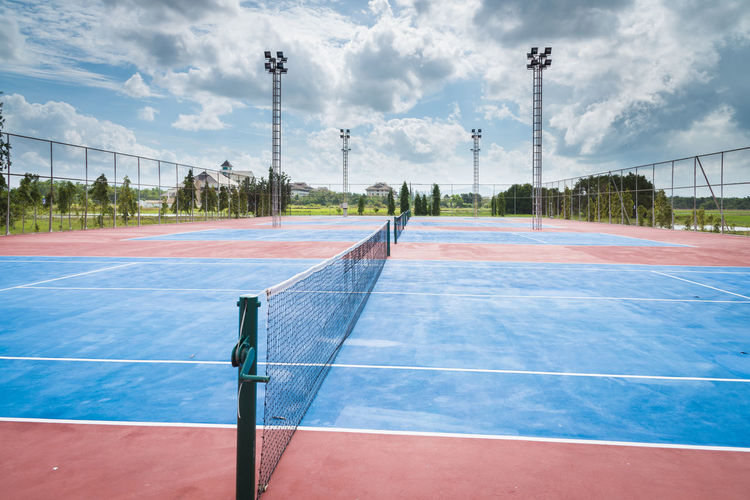 Scenic View Of Tennis Court Against Sky